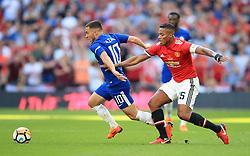 Chelsea's Eden Hazard (left) and Manchester United's Antonio Valencia battle for the ball
