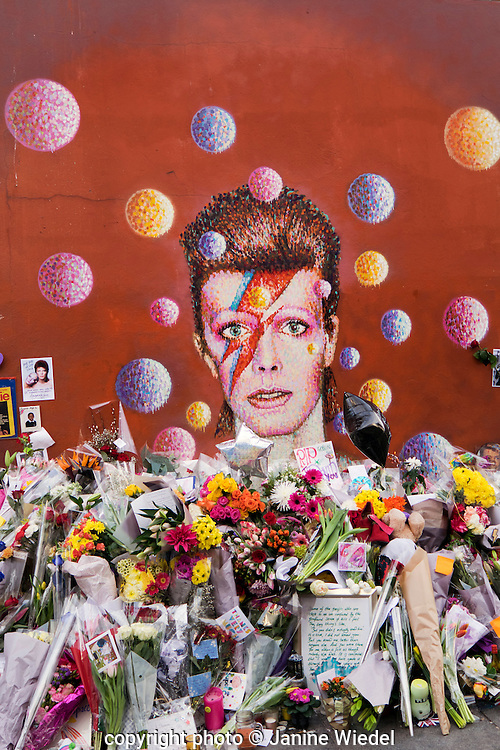 David Bowie memorial next to his mural in Brixton South London