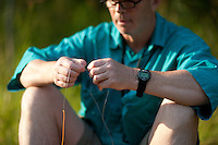 ANGLER TYING ON A CRAWFISH COLORED WOOLY BUGGER