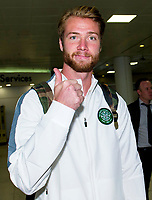 29/07/14   <br /> GLASGOW AIRPORT<br /> Thumbs up from new Celtic signing Jo Inge Berget as he meets up with squad ahead of flying to Warsaw
