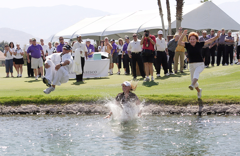 Rancho Mirage, CA, April 1, 2007:  Morgan Pressel and her caddie, Jon Yarbrough, are joined by Morgan's grandmother, Evelyn Krickstein, in the traditional jump into the pond after winning the 2007 LPGA Kraft Nabisco in Rancho Mirage, California. (Photo by Todd Bigelow/Aurora)