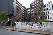 Old high rise buildings off Swallow Street in Birmingham city centre, which is virtually deserted under Coronavirus lockdown on a wet rainy afternoon on 28th April 2020 in Birmingham, England, United Kingdom. Britains second city has been in a state of redevelopment for some years now, but with many outdated architectural remnants still remaining, on a grey day, the urban landscape appears as if frozen in time. Coronavirus or Covid-19 is a new respiratory illness that has not previously been seen in humans. While much or Europe has been placed into lockdown, the UK government has put in place more stringent rules as part of their long term strategy, and in particular social distancing.