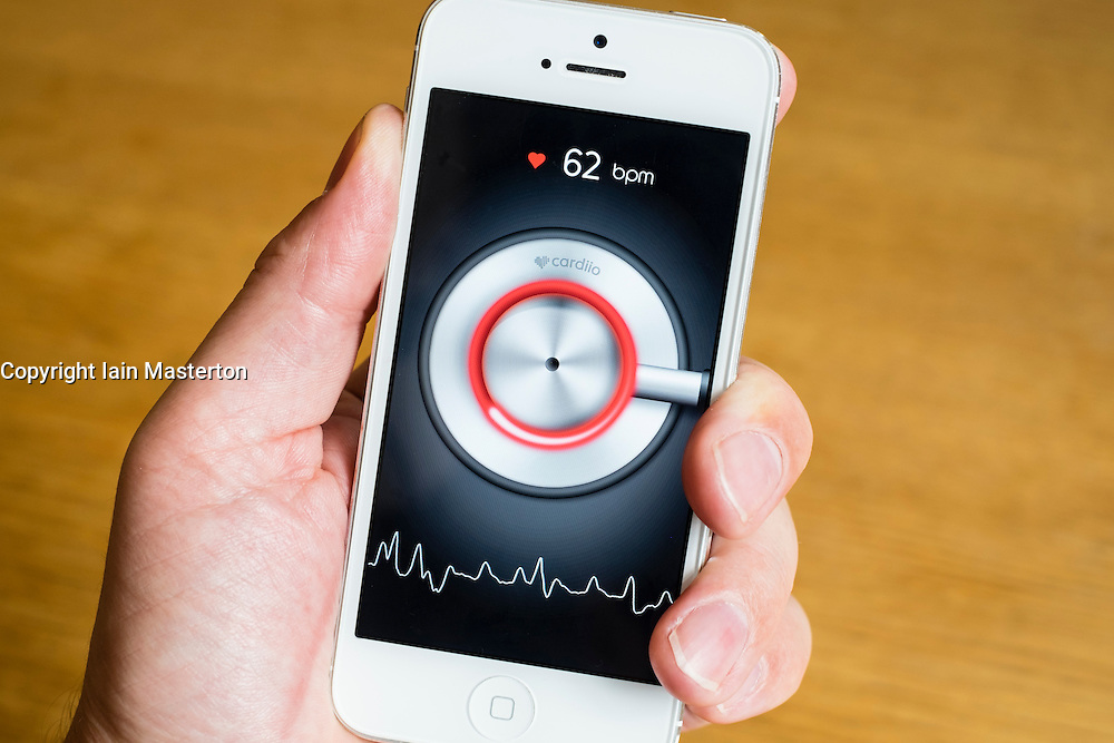 Detail of heart rate monitor health app on a iPhone smart phone, the camera and light from flash are used to measure pulse from fingertip