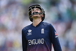 England's Joe Root shoes his dejection as he leaves the field after being dismissed for 46 during the ICC Champions Trophy, semi-final match at the Cardiff Wales Stadium.