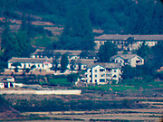 PAJU, GYEONGGI, SOUTH KOREA: North Korean worker housing in the southern most point in North Korea as seen from Odusan Unification Observatory, a South Korean tourist attraction that overlooks the DMZ. Tourism to the Korean DeMilitarized Zone (DMZ) has increased as the pace of talks between South Korea, North Korea and the United States has increased. Some tours are sold out days in advance.      PHOTO BY JACK KURTZ