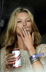 Kate Moss watches Pete Doherty on the Park stage at the 2007 Glastonbury Festival at Worthy Farm in Pilton, Somerset.