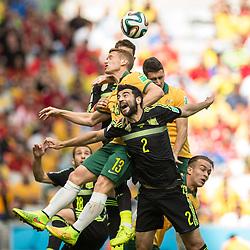 Jun 23, 2014 - Curitiba, Brazil - A mass of players go up for the ball during the World Cup Group B match between Australia and Spain, held at the Arena da Baixada in Curitiba, Brazil. Spain defeated Australia 3:0. (Credit Image: © Marcelo Machado De Melo/Fotoarena/ZUMAPRESS.com)