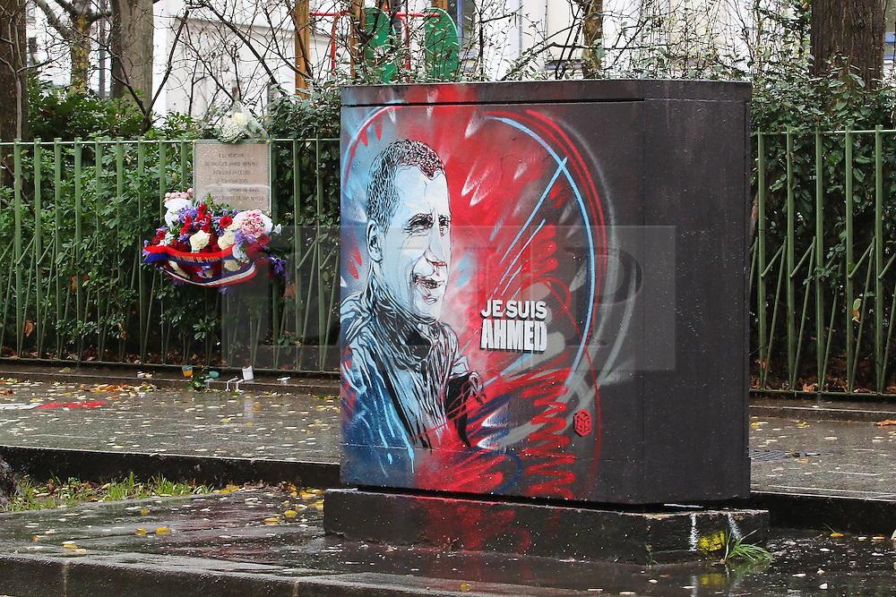© Licensed to London News Pictures. 07/01/2016. Paris, France. A phone box adorns graffiti which reads Je Suis Ahmed to remember Officer Ahmed Marabout who was killed during the Charlie Hebdo shootings on January 7th 2015. Today January 3rd 2016. Photo credit: Hugo Michiels/LNP