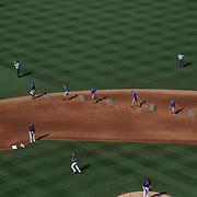 Ground crew prepare the infield between innings during the New York Mets Vs Arizona Diamondbacks MLB regular season baseball game at Citi Field, Queens, New York. USA. 11th July 2015. Photo Tim Clayton
