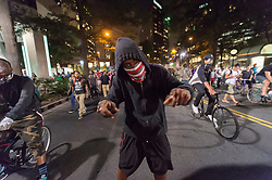 September 22, 2016 - Charlotte, North Carolina, United States of America - September 22, 2016 - Charlotte, NC, USA - A protestor during a third day of protests in Charlotte, North Carolina on Thursday, Sept. 22, 2016. This is the third day of protests that erupted after a police officer's fatal shooting of an African-American man Tuesday afternoon and the first full day of a declared State of Emergency by the governor. (Credit Image: © Sean Meyers via ZUMA Wire)