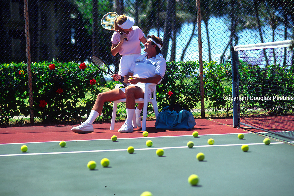 Couple playing tennis<br />