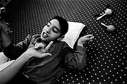 A child with physical and learning difficulties is coached through his exercises at the Peto Institute, Budapest
