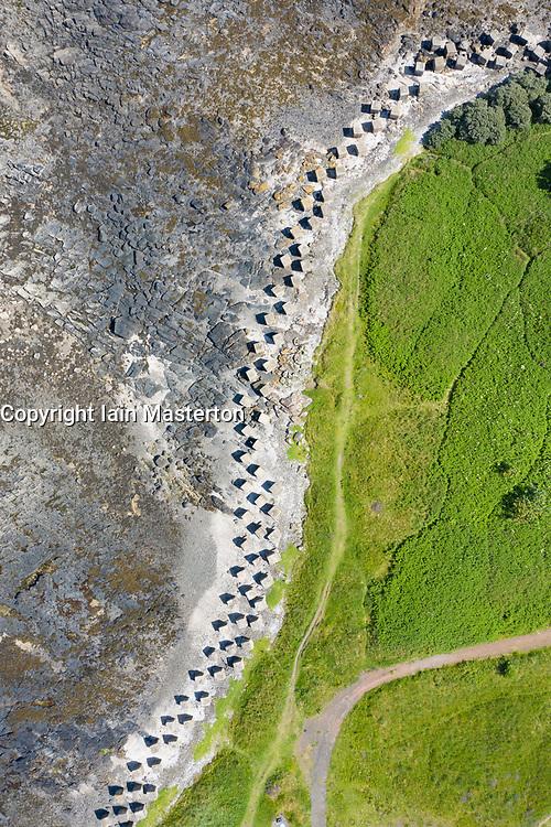 Aerial view of Second World War era anti-tank blocks on shore at Gosford Sands at Longniddry in East Lothian, Scotland, UK