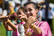 "28 AUGUST 2014 - BANGKOK, THAILAND: A Thai dancer performs during the opening ceremonies at the King's Cup Elephant Polo Tournament at VR Sports Club in Samut Prakan on the outskirts of Bangkok, Thailand. The tournament's primary sponsor in Anantara Resorts. This is the 13th year for the King's Cup Elephant Polo Tournament. The sport of elephant polo started in Nepal in 1982. Proceeds from the King's Cup tournament goes to help rehabilitate elephants rescued from abuse. Each team has three players and three elephants. Matches take place on a pitch (field) 80 meters by 48 meters using standard polo balls. The game is divided into two 7 minute ""chukkas"" or halves.     PHOTO BY JACK KURTZ"