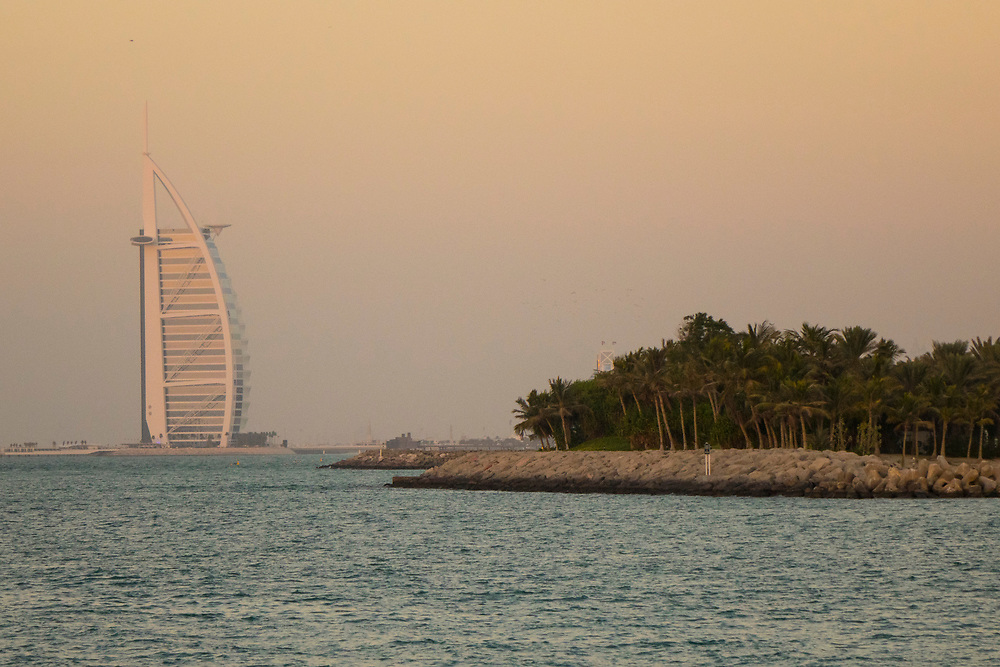 The Burj Al Arab Hotel (Tower of the Arabs) in the Persian Gulf. The shape of the structure is designed to resemble the sail of a ship. It is one of the tallest hotels in the world,
