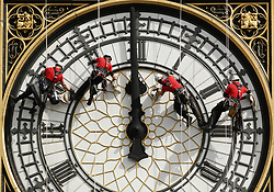 A specialist technical abseil team clean and inspect one of the four faces of the Great Clock, otherwise known as Big Ben, at the Houses of Parliament, in central London, as they undertake essential maintenance and cleaning of the four faces.