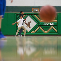 From left Mackenzie Shirley, Cordell Platero and Kylee DeGroat play a short pick up game of basketball during half time of the Navajo Pine verses Thoreau girls basketball game Tuesday in Thoreau.