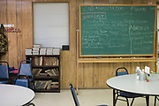 DURANT, OKLAHOMA - MARCH 24:  A chalk board with a prayer list and the days menu sits against the wall at the Bryan County Retired Senior Volunteer Program in Durant, Oklahoma on March 24, 2017. (Photo by Cooper Neill for The Washington Post)