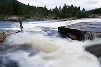 Flyfishing by River Orkla, Rennebu, Norway<br /> Model name: Krister Hoel. Model release valid by the photographer.