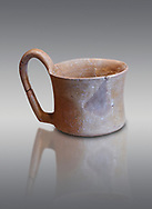 Hittite terra cotta big handled tankard mug. Hittite Empire, Alaca Hoyuk, 1450 - 1200 BC. Alaca Hoyuk. Çorum Archaeological Museum, Corum, Turkey .<br />  <br /> If you prefer to buy from our ALAMY STOCK LIBRARY page at https://www.alamy.com/portfolio/paul-williams-funkystock/hittite-art-antiquities.html  - Alaca Hoyuk into the LOWER SEARCH WITHIN GALLERY box. Refine search by adding background colour, place,etc<br /> <br /> Visit our HITTITE PHOTO COLLECTIONS for more photos to download or buy as wall art prints https://funkystock.photoshelter.com/gallery-collection/The-Hittites-Art-Artefacts-Antiquities-Historic-Sites-Pictures-Images-of/C0000NUBSMhSc3Oo