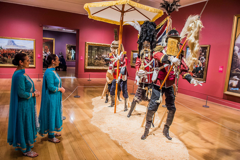 Artists, The Singh Twins view British Infantry advance on Jerusalem, 4th of July 1879 and instlallation by Andrew Gilbert, 2015 - Artist and Empire - a new Tate Britain exhibition about Imperial visual culture, examining the people who helped to create or confront the British Empire in their art. It features over 200 paintings, drawings, photographs, sculptures and artefacts from across the British Isles, North America, the Caribbean, the Pacific, Asia and Africa. Exhibition highlights include: Major historic paintings by the likes of Johan Zoffany, George Stubbs, Lady Butler Anthony Van Dyck and Thomas Daniell; Rare Maori portraits which are being exhibited in London for the first time in almost 100 years; The first chance to photograph one of the nation's favourite paintings, The North-West Passage 1874 by John Everett Millais since undergoing new conservation; and new work by artist Andrew Gilbert, made especially for the exhibition. Artist and Empire at Tate Britain from 25 November 2015 to 10 April 2016.