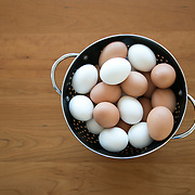 """Brown and white eggs in a black colander.<br /> <br /> For all details about sizes, paper and pricing starting at $85, click """"Add to Cart"""" below."""