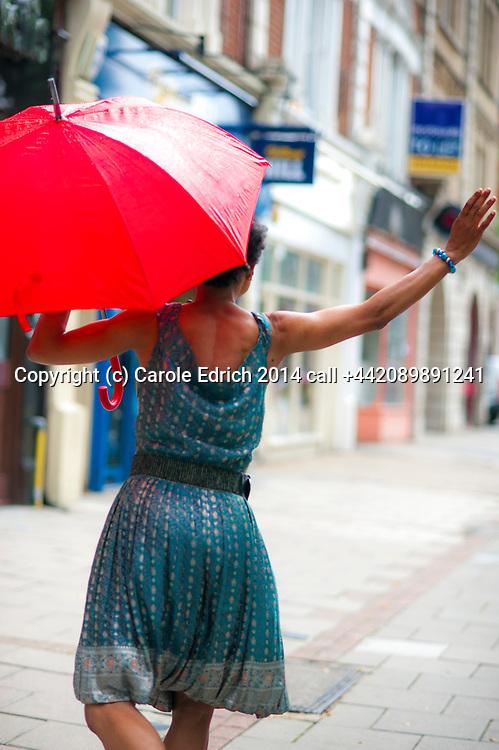 Vanessa Downie dancing in light rain in Wanstead High Street, part of the Angels of Wanstead series, photo Carole Edrich August 2, 2014