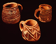 Ancestral Pueblo mugs, Pueblo II-III, McElmo Black-on-White in front and two Mesa Verde Black-on-White mugs in back, Edge of the Cedars State Park Museum, Blanding, Utah. (ECPR-3445, ECPR-3754. ECPR-3335)   Mugs owned by the Utah Navajo Development Council / Utah Navajo Trust Fund.  Contact Fred Hirschmann prior to any publication.