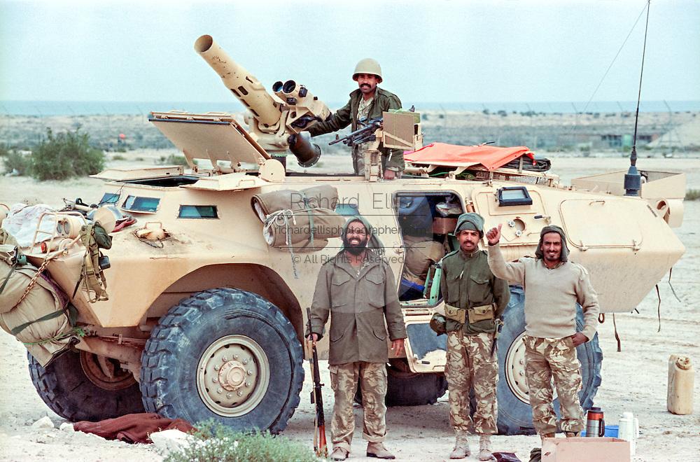 Saudi Arabian soldiers stand guard near the border with Kuwait following the Battle of Khafji February 2, 1991 in Khafji City, Saudi Arabia. The Battle of Khafji was the first major ground engagement of the Gulf War.