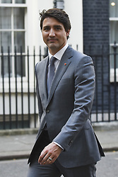 April 18, 2018 - London, England, United Kingdom - Prime Minister of Canada, Justin Trudeau leaves Downing Street, after attending a bilateral meeting with British Prime Minister Theresa May on April 18, 2018 in London, England. Mrs May holds bilateral talks with a number of Commonwealth leaders today as the UK this week hosts heads of state and government from the Commonwealth nations. (Credit Image: © Alberto Pezzali/NurPhoto via ZUMA Press)