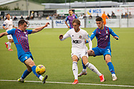 Cove Rangers' Broque Watson (7) and Inverness Caledonian Thistle's Cameron Harper (3) battles for possession, tussles, tackles, challenges, during the Premier Sports Scottish League Cup match between Cove Rangers and Inverness CT at Balmoral Stadium, Aberdeen, Scotland on 20 July 2021.