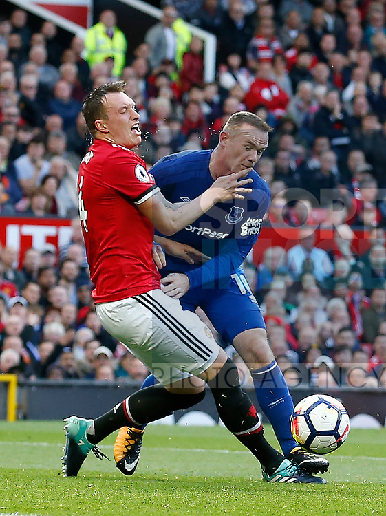 Phil Jones of Manchester United tackles Wayne Rooney of Everton during the premier league match at the Old Trafford Stadium, Manchester. Picture date 17th September 2017. Picture credit should read: Simon Bellis/Sportimage