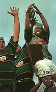 Tetley Bitter Cup Qtr - Final.  Harlequins V Northampton..Stoop Memorial Ground - Twickenham - Middlx...The 'wet' ball slips through the hands of Quins jumper Steve White Cooper............   [Mandatory Credit, Peter Spurier/ Intersport Images].