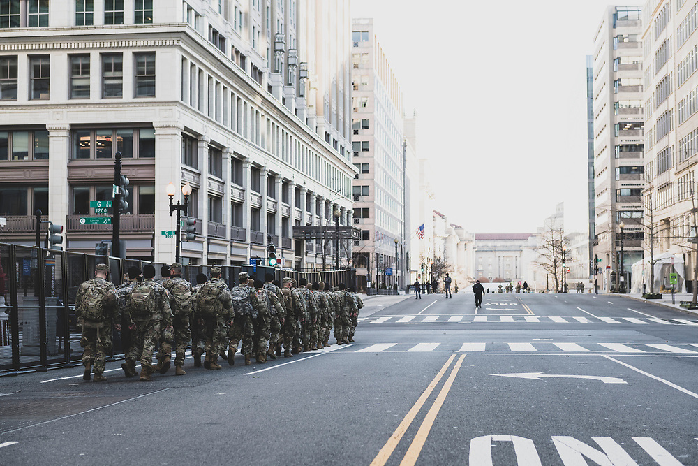 Washington DC, USA - January 19, 2021: Members of the Indiana National Guard walk down 13th Street NW on the eve of the Biden Inauguration