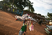 A street vendor, foreground, sells variety of goods in a neighborhood in Bangui. Many young boys and men become street vendors due to lack of education and resources.