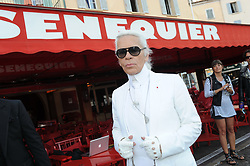 Karl Lagerfeld and Jean Roch are seen filming a video outside of Senequier in Saint-Tropez, south of France, August 19, 2011. Photo by Rachid Bellak/ABACAPRESS.COM