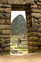 Huayna Picchu (Wayna Picchu) farned by a classic incan doorway at Machu Picchu in the Peruvian Andes