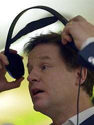 © Licensed to London News Pictures. 13/11/2012. London, UK Nick Clegg conducts a radio interview.  Deputy Prime Minister Nick Clegg visits the 'Third Door', in Putney today Putney today, 13 November 2012. An innovative centre combining a workspace for parents and childcare for their children, parents can drop off their children in the nursery, and hire a working space including desk, meeting room and facilities.  He announced new flexible parental leave for parents, mothers and fathers can now share the maternity leave allowance.. Photo credit : Stephen Simpson/LNP