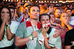 © Licensed to London News Pictures. 11/07/2018. London, UK. England fans in Flat Iron Square react as the final whistle goes and England lose to Croatia in the World Cup semi-final. Photo credit: Rob Pinney/LNP