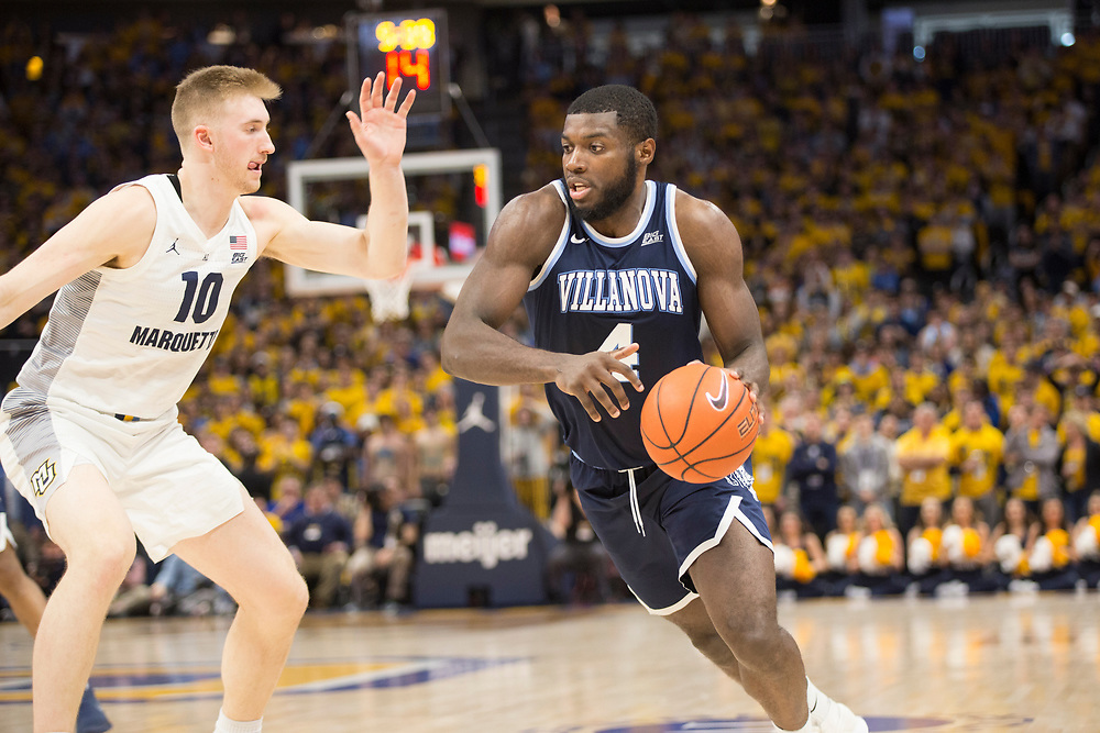 Sam Hauser defends Eric Paschall as the Marquette Golden Eagles host the Villanova Wildcats on February 9, 2019.