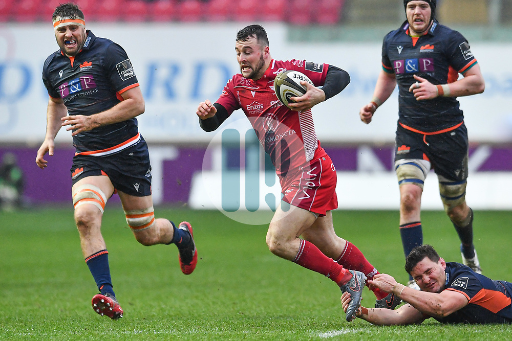 Ryan Conbeer of Scarlets is tackled by David Cherry of Edinburgh<br /> <br /> Photographer Craig Thomas/Replay Images<br /> <br /> Guinness PRO14 Round 11 - Scarlets v Edinburgh - Saturday 15th February 2020 - Parc y Scarlets - Llanelli<br /> <br /> World Copyright © Replay Images . All rights reserved. info@replayimages.co.uk - http://replayimages.co.uk