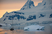 Sailboat near Akademik Vernadsky Station on Galendez Island. Built and previously operated by the British. Its claim to fame is the discovery by British scientists, at what was then called Halley Station, of the hole in the ozone layer in 1985. Antarctica.