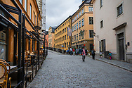 Stockholm, Sweden -- July 16, 2019. People walk around Old Town in Stockholm; tourists do some window shopping.