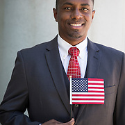 """The Democratic and Republican parties set-up voter registration tables immediately outside a naturalization ceremony where more than 5000 Immigrants were sworn in as new citizens of the United States. The """"New Americans"""" were solicited by both parties to register so they can vote in the 2016 election."""