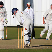 Dumfries v Ayr.  At Nunholm.  Ayr bowler Scott McElnea bowls Ayr captain Stuart Corbett-Byres for the all important 7th wicket which won the championship for Ayr. Scott <br />  Picture Robert Perry 30th Aug 2014