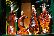 Corfu traditional kumquat liquor bottles .<br /> <br /> If you prefer to buy from our ALAMY PHOTO LIBRARY  Collection visit : https://www.alamy.com/portfolio/paul-williams-funkystock/corfugreece.html <br /> <br /> Visit our GREECE PHOTO COLLECTIONS for more photos to download or buy as wall art prints https://funkystock.photoshelter.com/gallery-collection/Pictures-Images-of-Greece-Photos-of-Greek-Historic-Landmark-Sites/C0000w6e8OkknEb8
