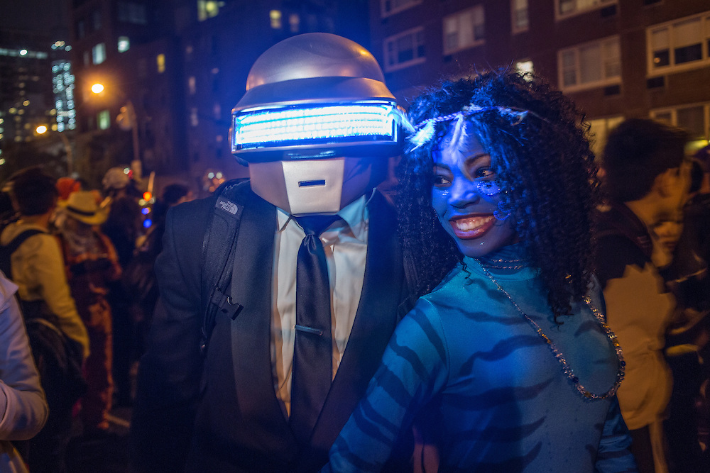 New York, NY, October 31, 2013. A man in a helmet and a woman in a blue costume in the Greenwich Village Halloween Parade.