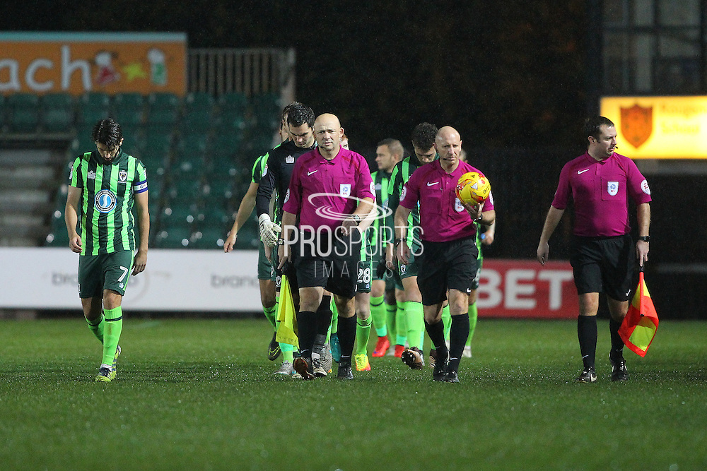 referee Andy Davies is unable to continue, due to an injury and there is no 4th official so a tannoy message has asked if there is any fully qualified official in the stand during the EFL Check-a-Trade Trophy matches. EFL Trophy Southern Group B match between Newport County and AFC Wimbledon at Rodney Parade, Newport, Wales on 8 November 2016. Photo by Stuart Butcher.