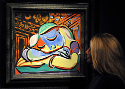 © licensed to London News Pictures. LONDON, UK.  13/06/11. A woman looks at 'Jeune fille endormie', 1935 by Pablo Picasso (1881-1973) it is expected to fetch £9-12Million at auction on 21st June 2011. Photo call at Christie's, London, for the unveiling of rarely seen masterpieces by Picasso, Michelangelo and Gainsborough before they are offered for sale. Photo credit should read Stephen Simpson/LNP