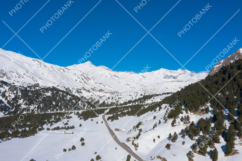 Panorama with lots of snow on Lukmanier in Ticino, on the Swiss Alps. Beautiful landscape, aerial point of view of mountains and valley. Nobody inside